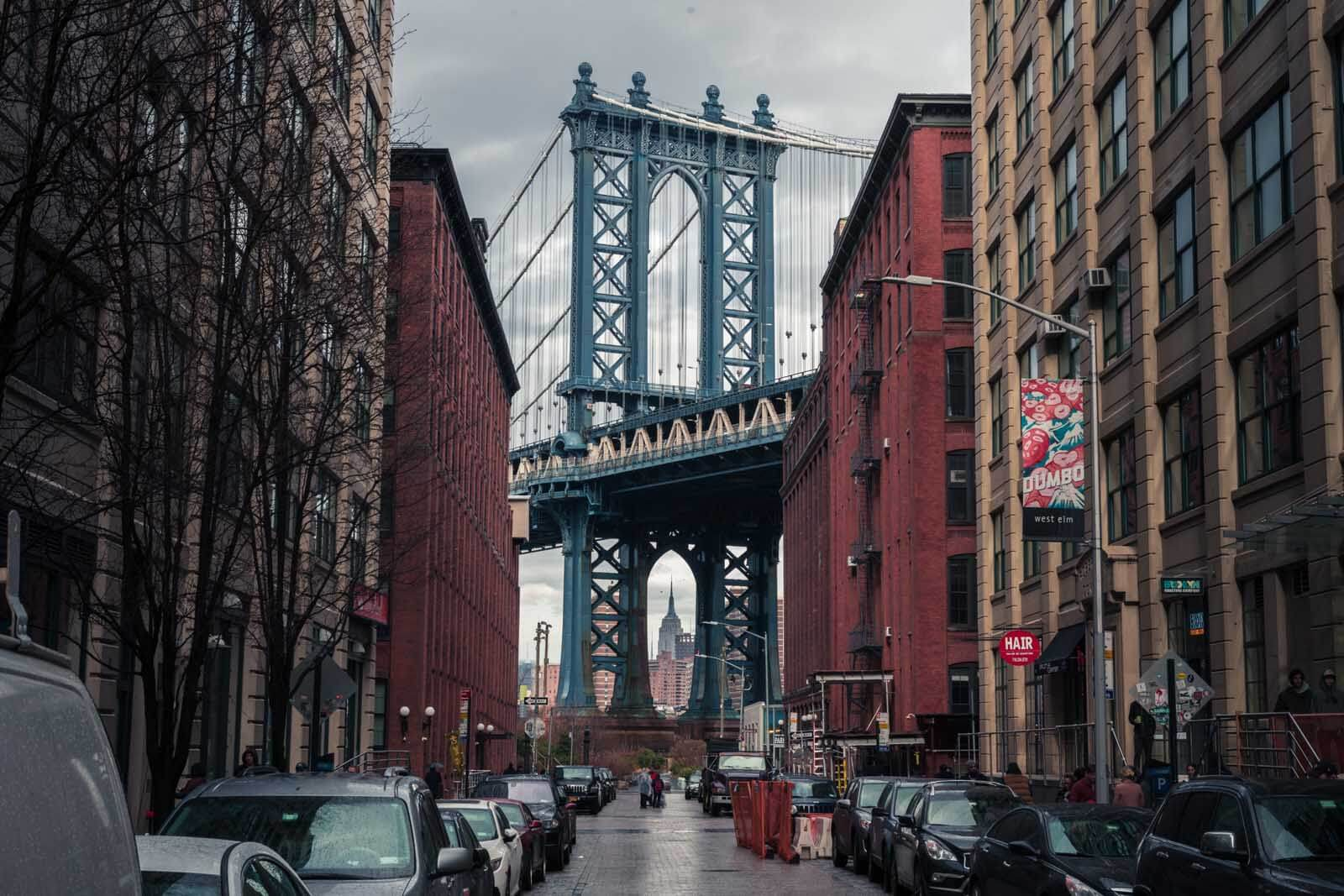Manhattan Bridge and Empire State Building view in DUMBO Brooklyn