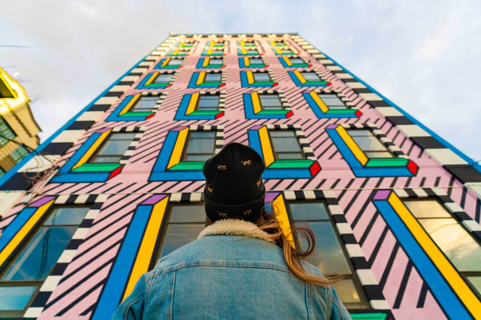 looking up at the mural at Industry City Camille Walala Mural in Brooklyn