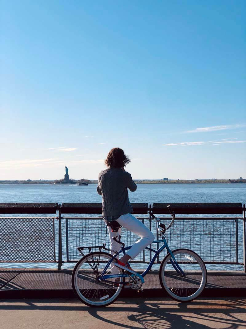 cyclist taking a photo from Louis Valentino Jr Park in Red Hook Brooklyn