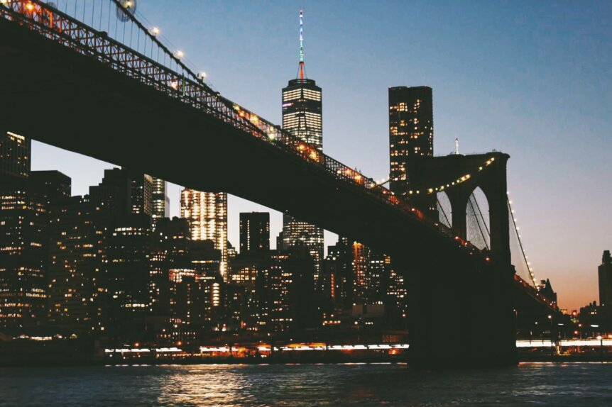 The brooklyn bridge at night by Katie Hinkle