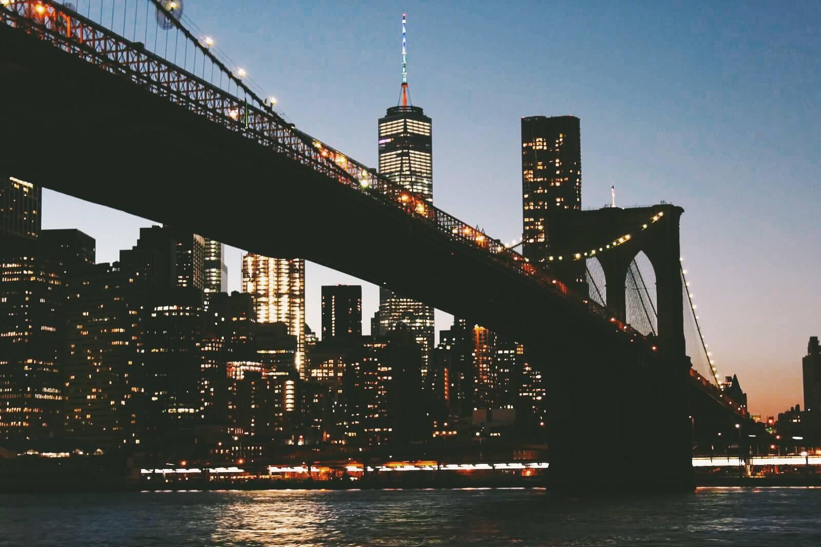 The brooklyn bridge at night by Katie Hinkle