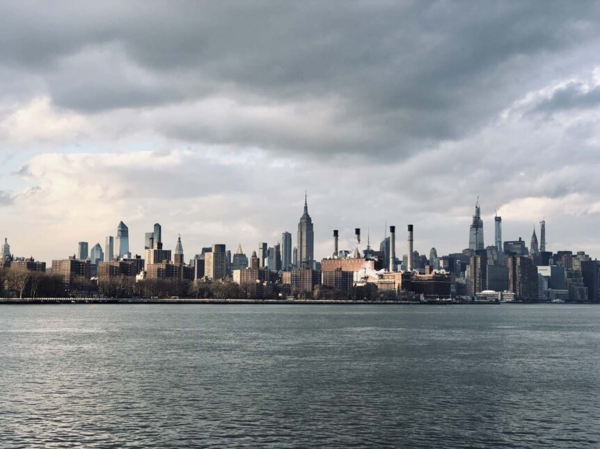 View of Manhattan with a bit of mood from Domino Park in Williamsburg Brooklyn