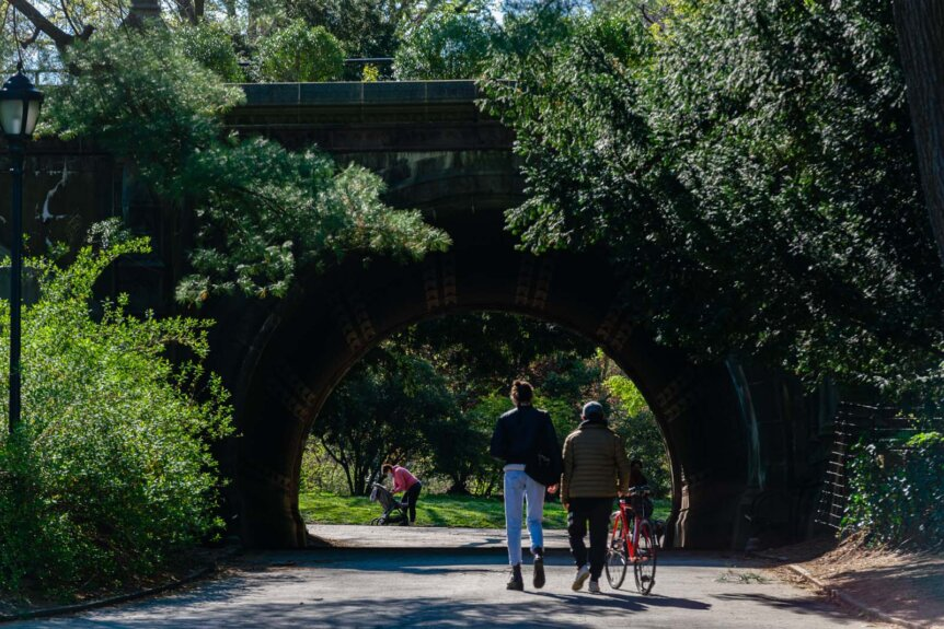 Family walking to cleft ridge arch in prospect park
