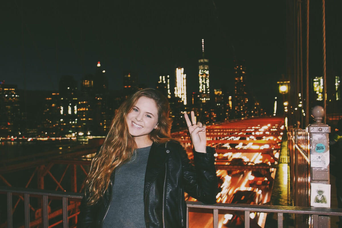 Katie-Posing-on-the-Brooklyn-Bridge-at-night-by-Katie-Hinkle