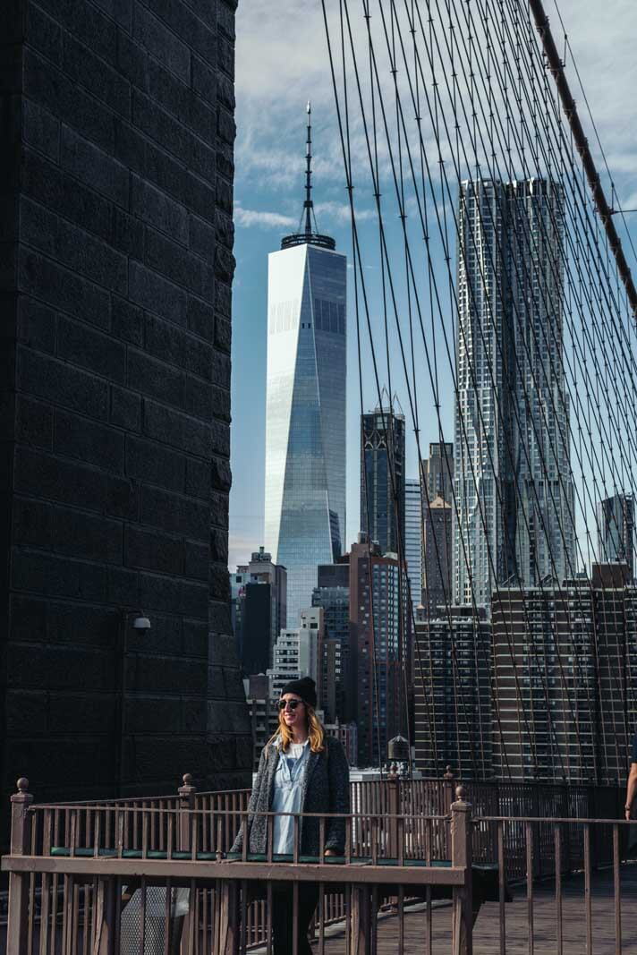 Megan on the Brooklyn Bridge with the WTC in the background