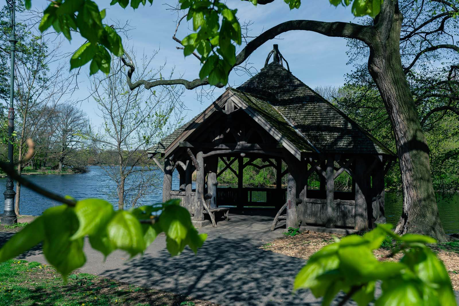 cool wooden shelter in prospect park on lake