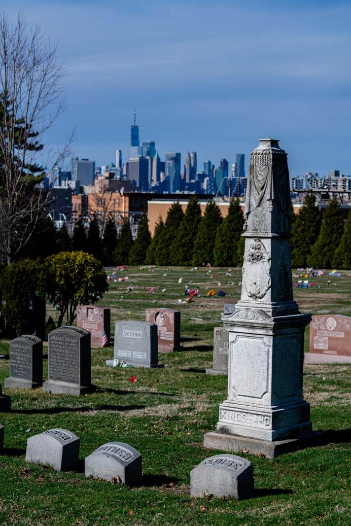 gravestones with view of manhattan in background at greenwood cemetery in brooklyn