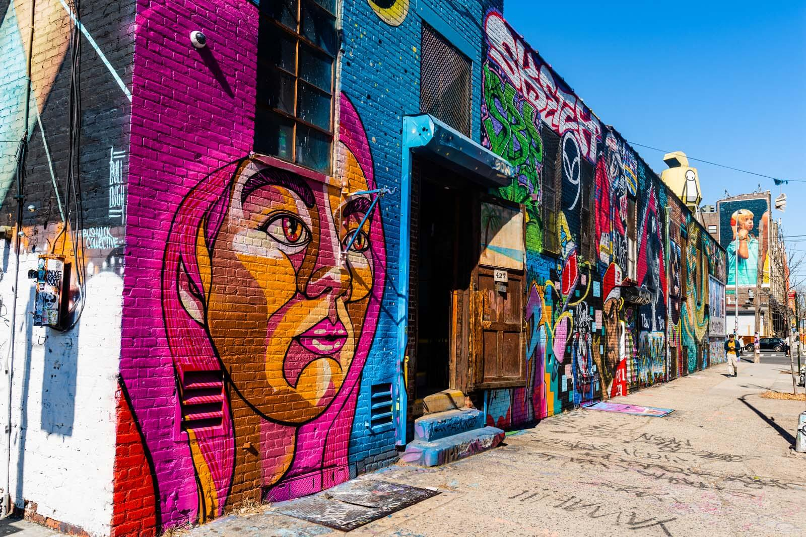 wall of several colorful murals in Bushwick