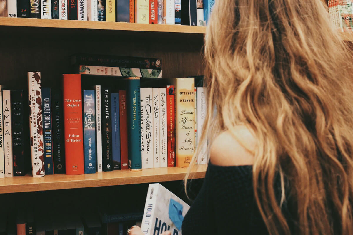reading-a-book-at-Greenlight-Bookstore-in-Fort-Greene-by-Katie-Hinkle