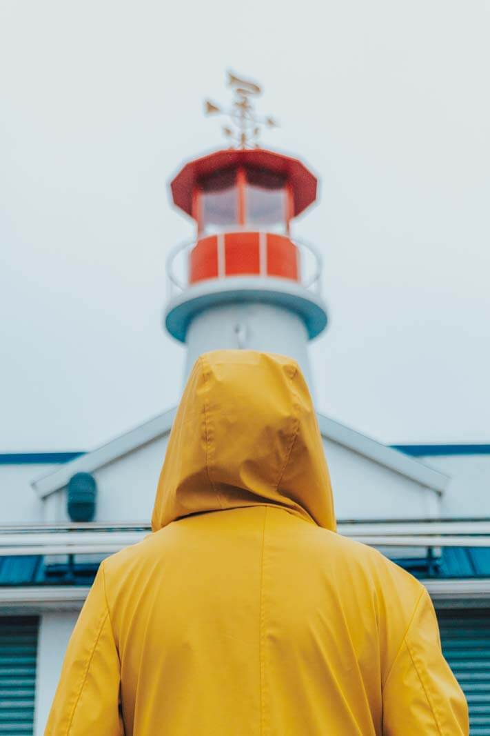 Megan looking at the lighthouse on Rieggleman Boardwalk in Coney Island Brooklyn on a rainy day