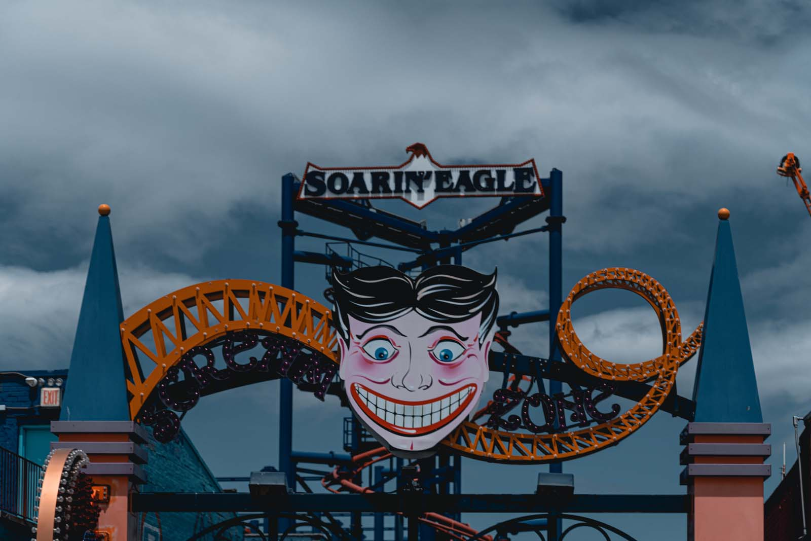 Scream zone sign and rides at Coney Island