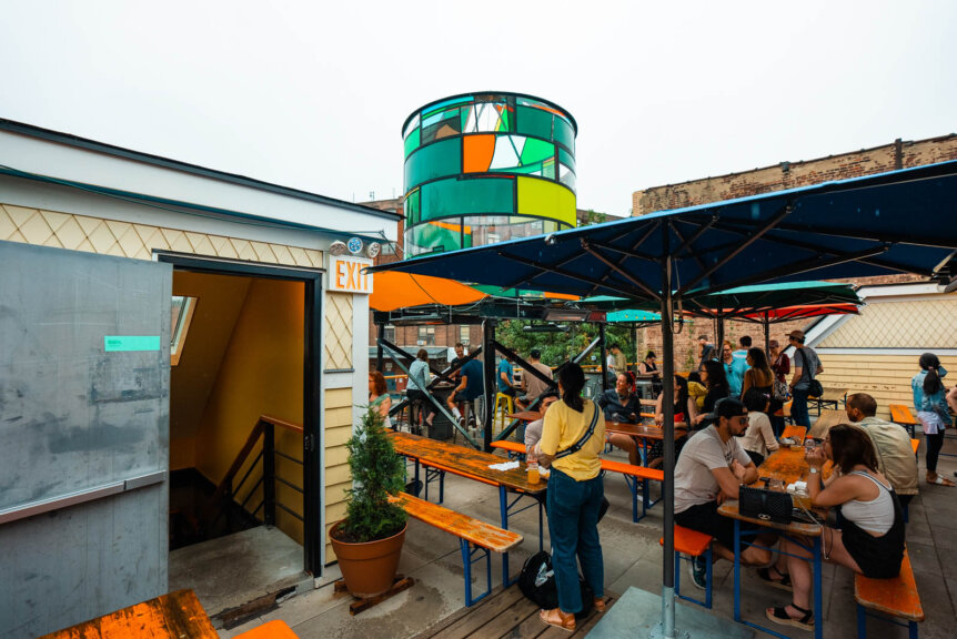 Greenpoint Beer and Ale Co outdoor rooftop seating area in Brooklyn plus glass watertower