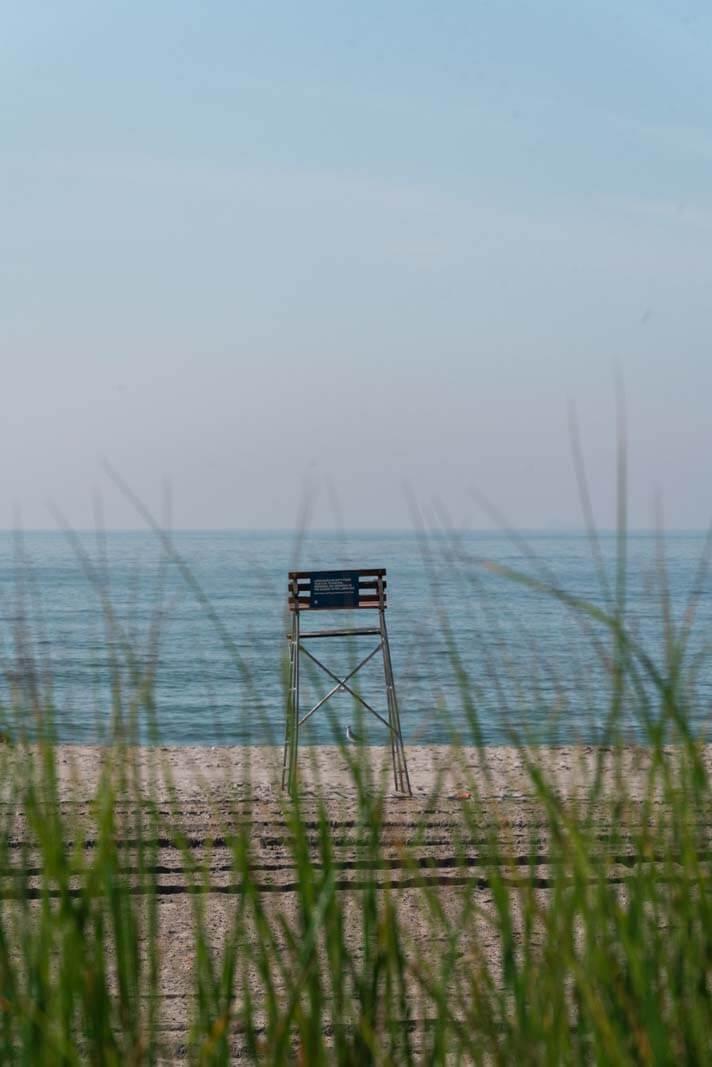 lifeguard chair through the grass at Rockaway Beach