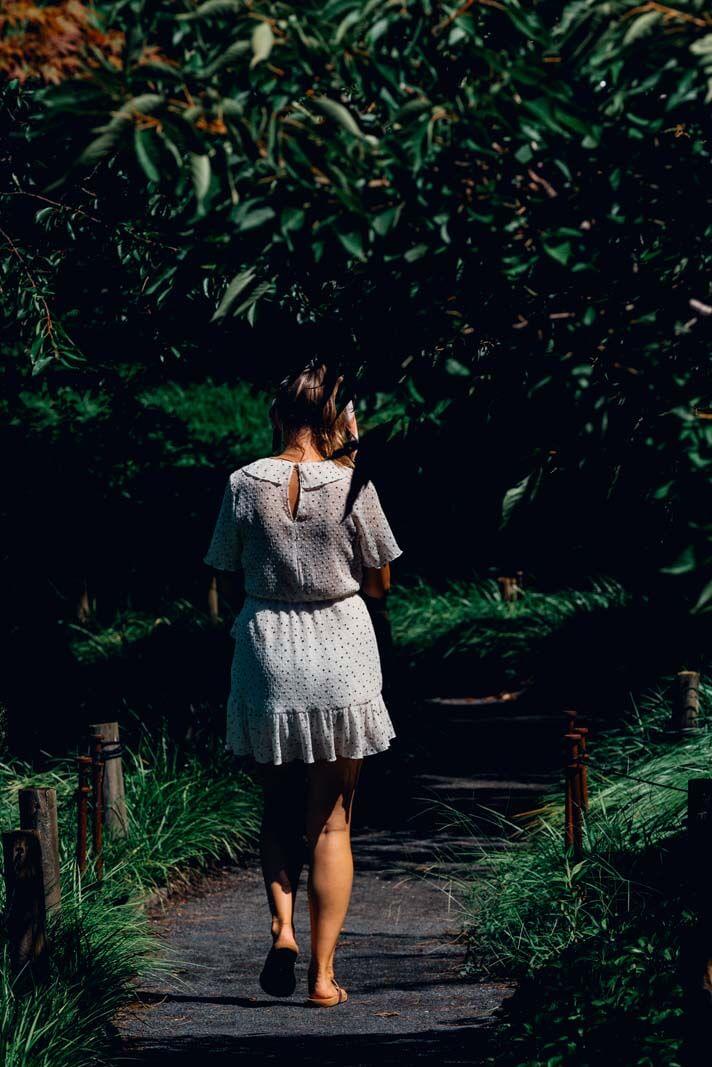 walking through a pretty grassy pathway in Brooklyn Botanical