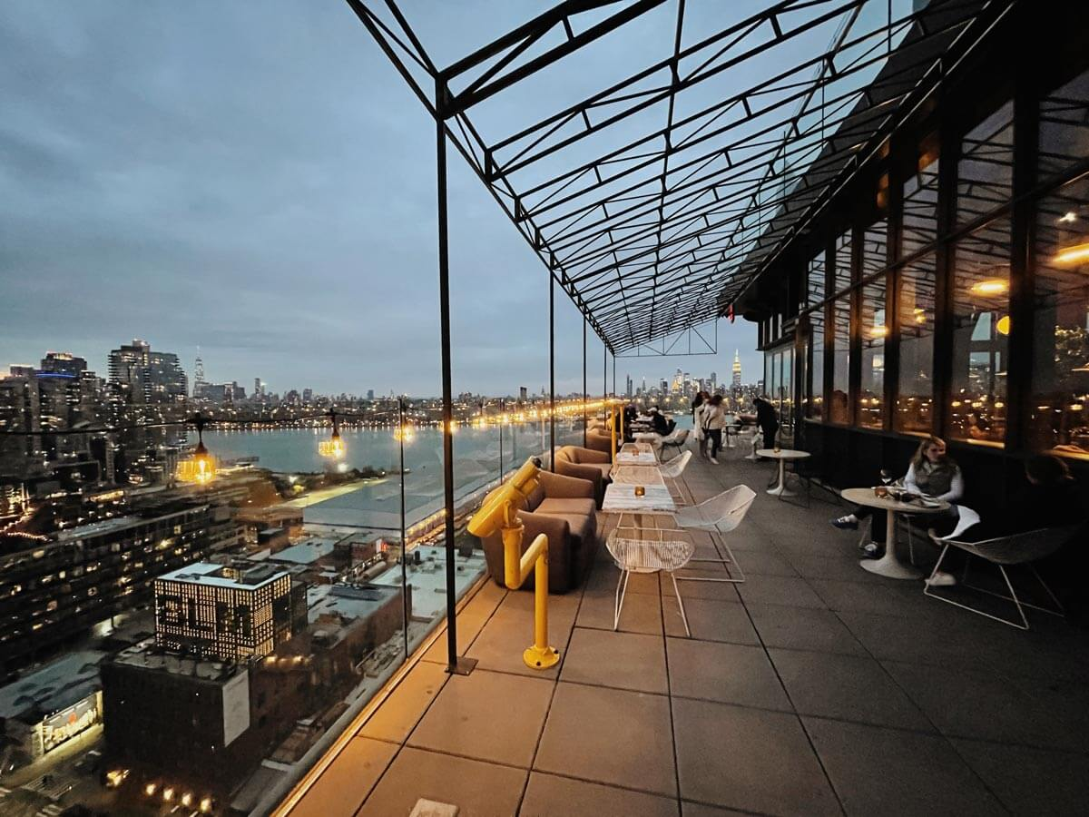 view of the rooftop bar at westlight at the william vale hotel in williamsburg brooklyn