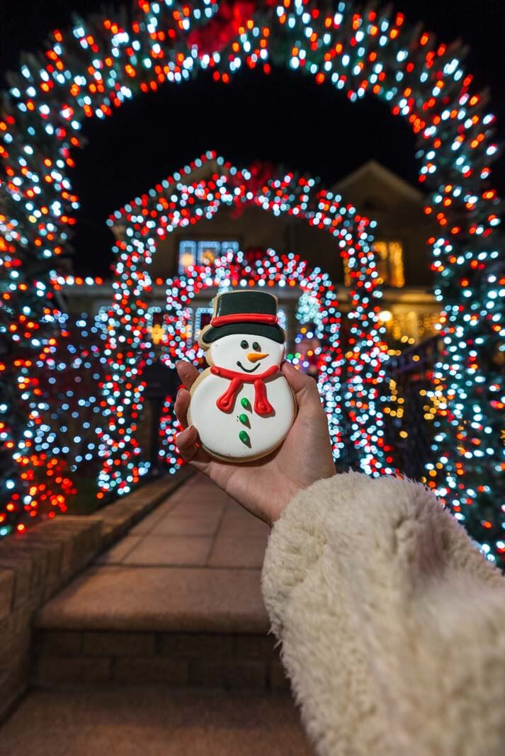 holiday snowman cookie from Tasty Pastry shoppe in Dyker Heights Brooklyn with christmas lights