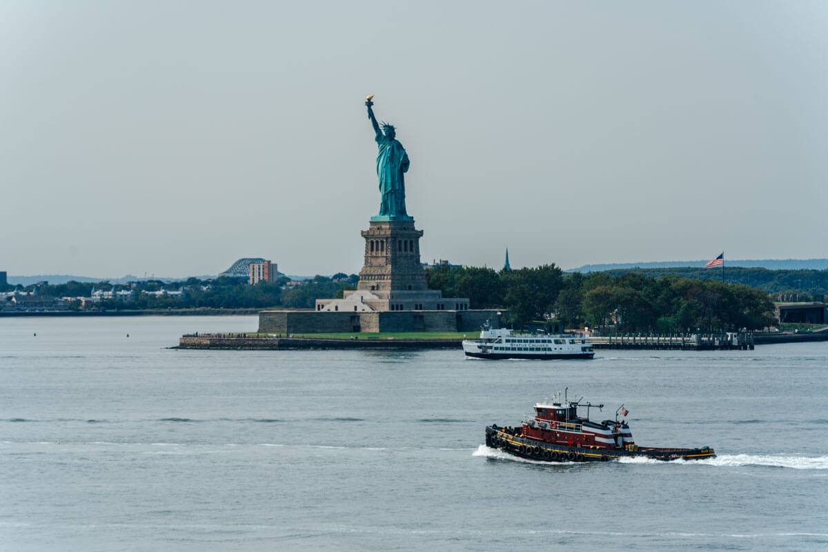 Statue-of-Liberty-with-boats-view-from-Governors-Island-in-NYC