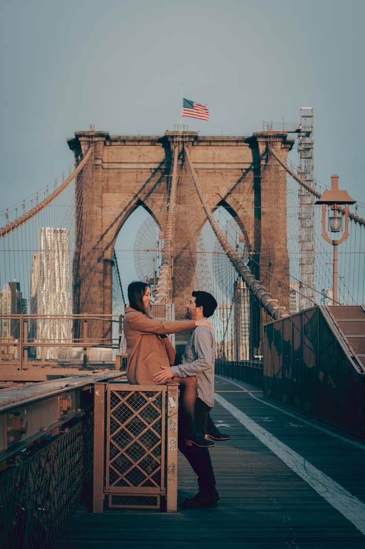 happy couple on Brooklyn Bridge photo shoot