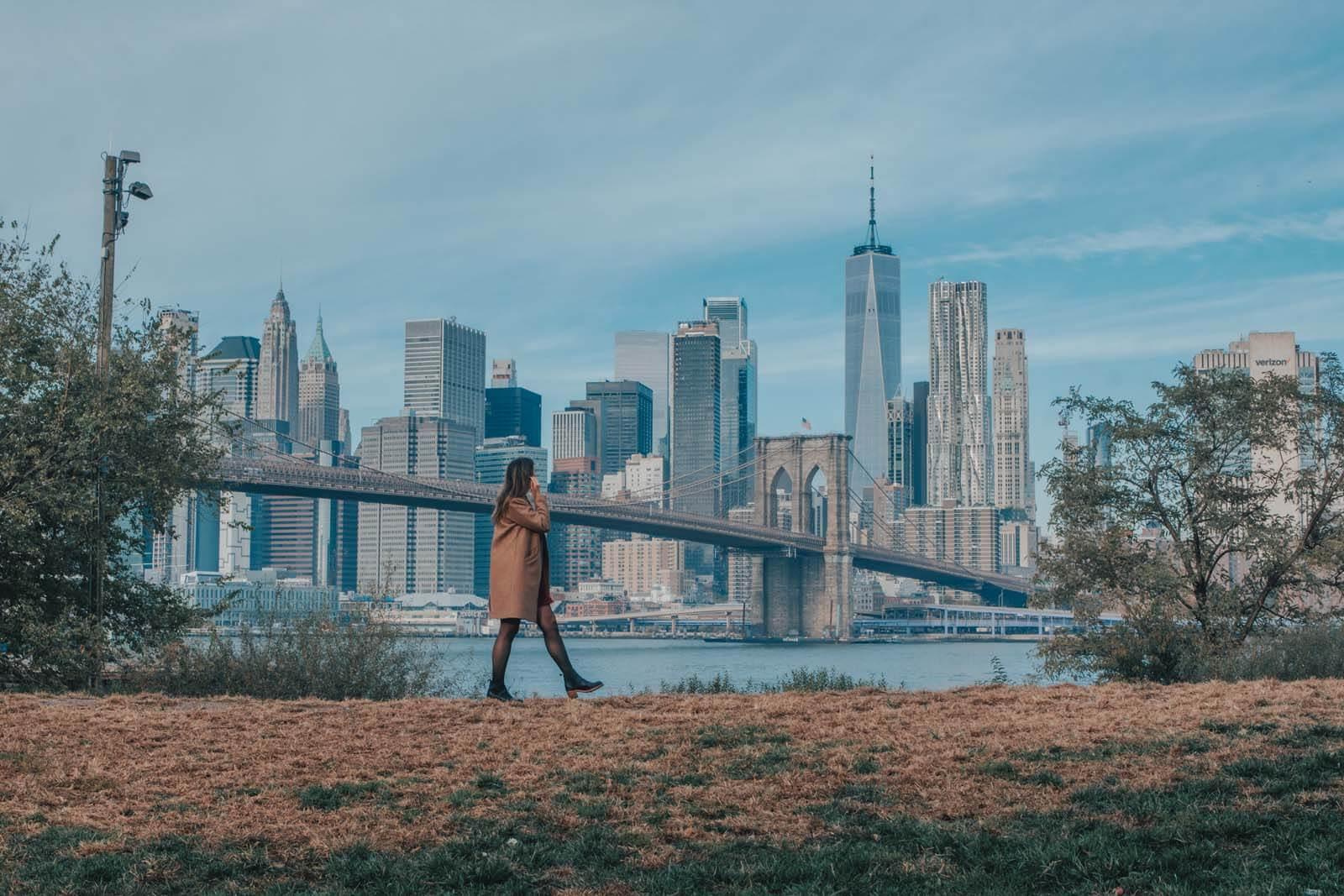 view from Brooklyn Bridge Park of Brooklyn Bridge and NYC skyline