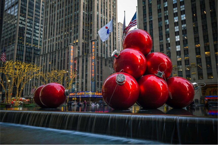 Giant Christmas ornaments on 6th avenue and radio city music hall at christmas in nyc