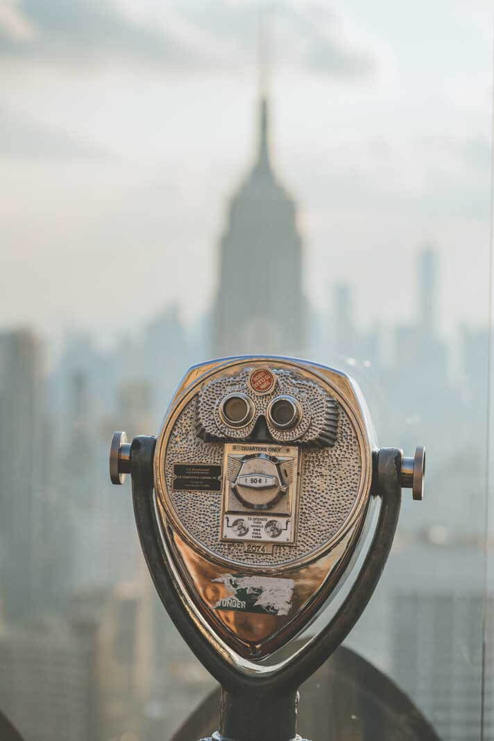 look through to see the empire state building from top of the rock in manhattan nyc