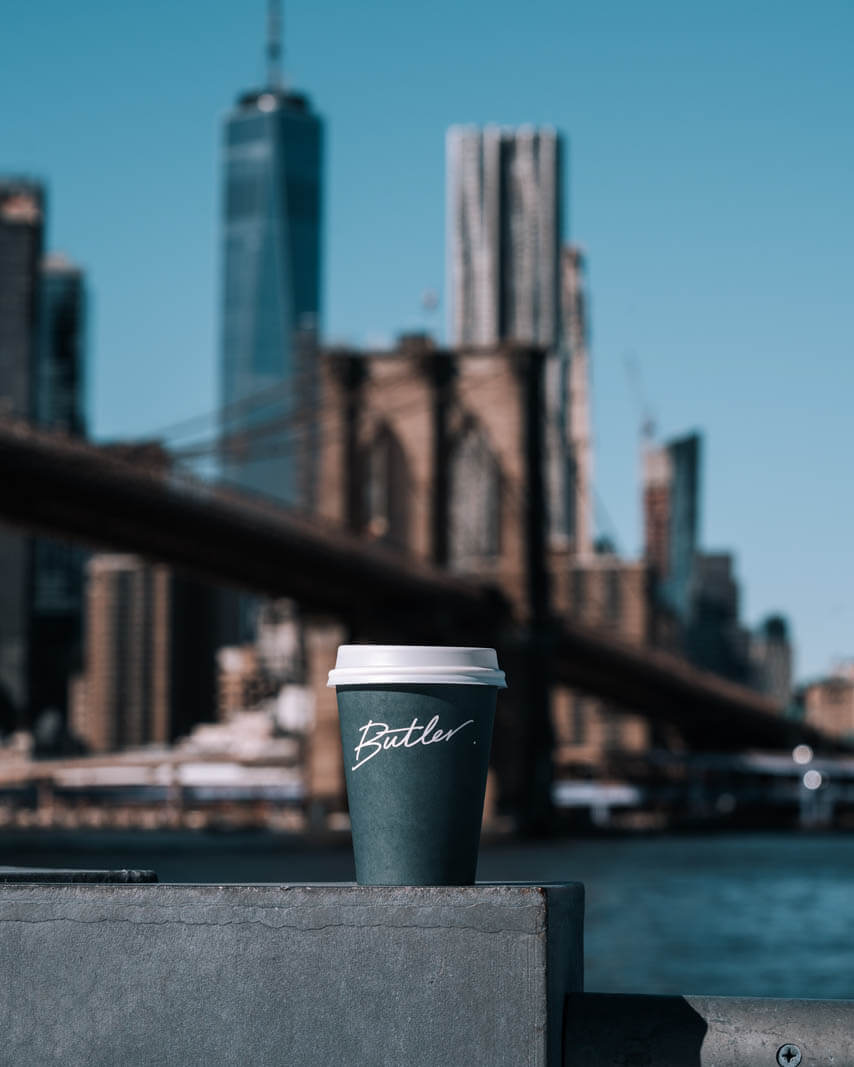 Butler Coffee with a view of the Brooklyn Bridge and city skyline in DUMBO Brooklyn