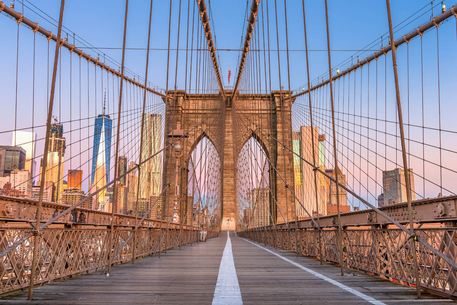 Brooklyn Bridge Promenade with the New York City skyline.