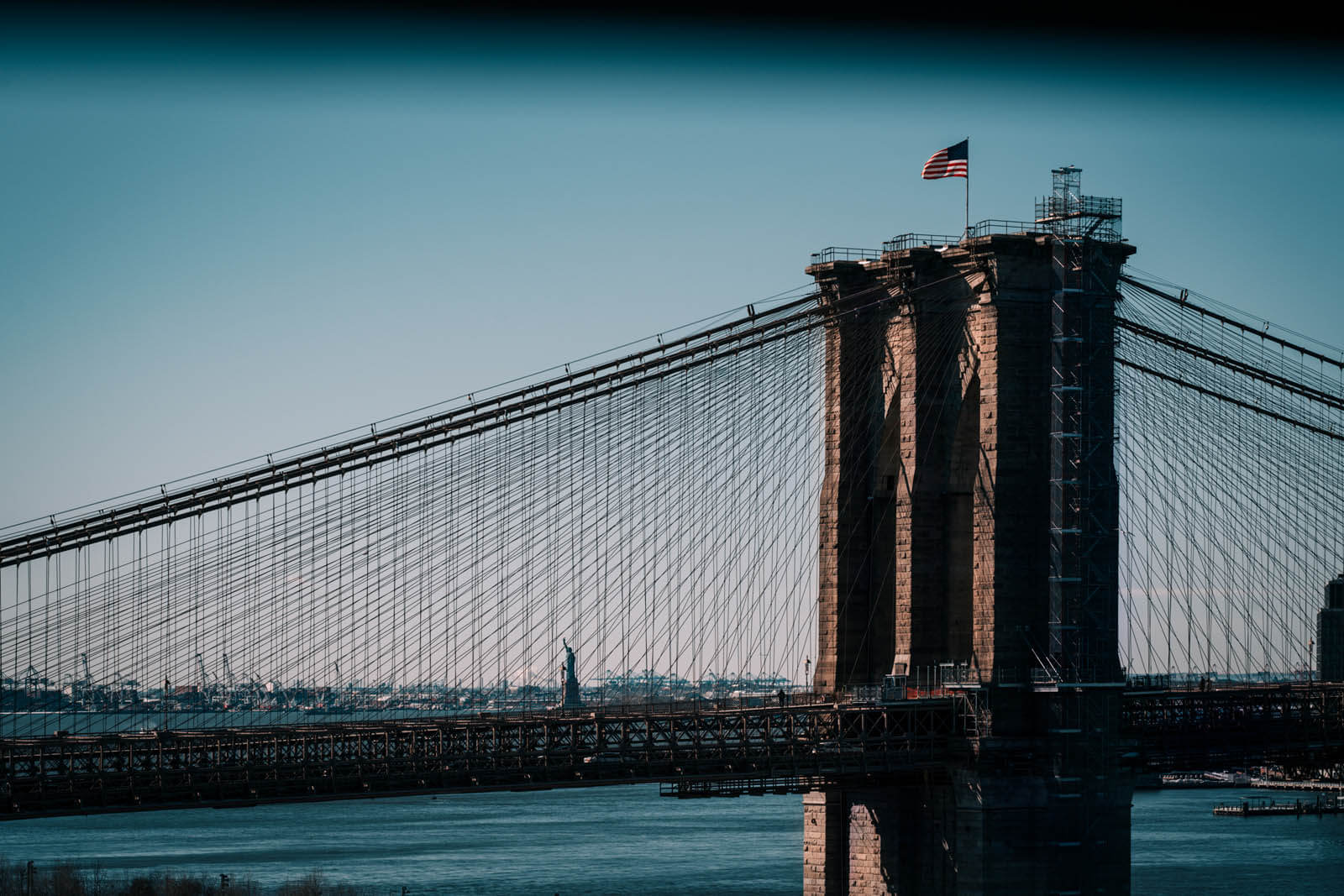 View of Statue of Liberty and Brooklyn Bridge from Manhattan Bridge in NYC