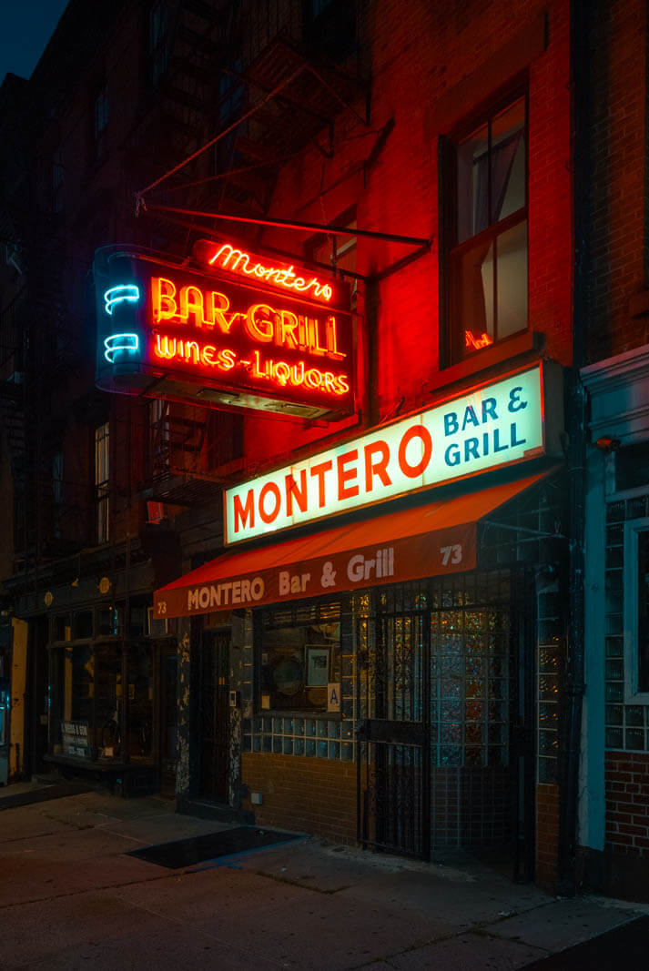 Montero's neon sign lit up at night in Brooklyn Heights on Atlantic Avenue