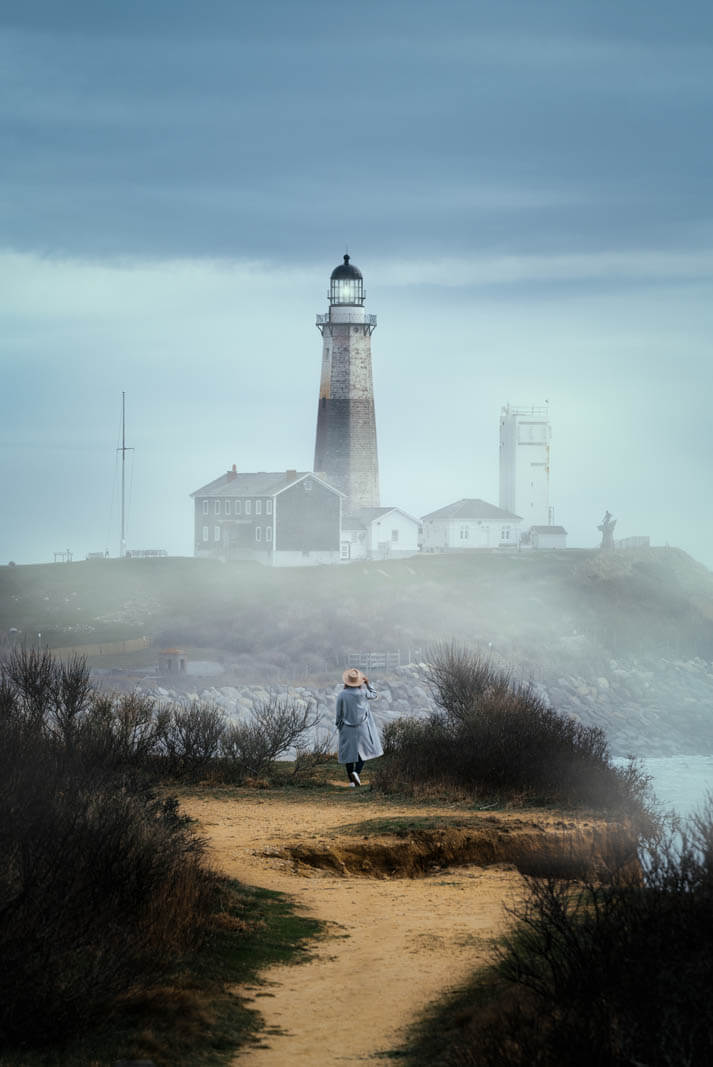 View of Montauk Point Lighthouse from Camp Hero State Park Bluffs in the Hamptons New York