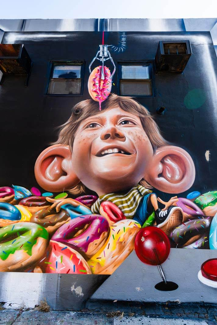 big ear and donut mural at the Bushwick Collective in Brooklyn