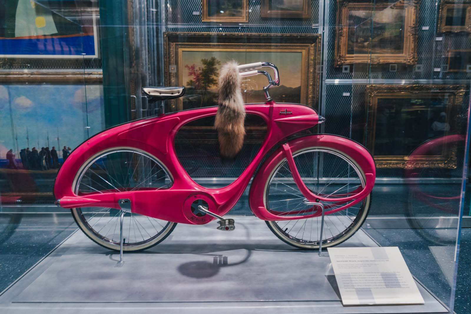 pink bicycle in visible storage in the Brooklyn Museum