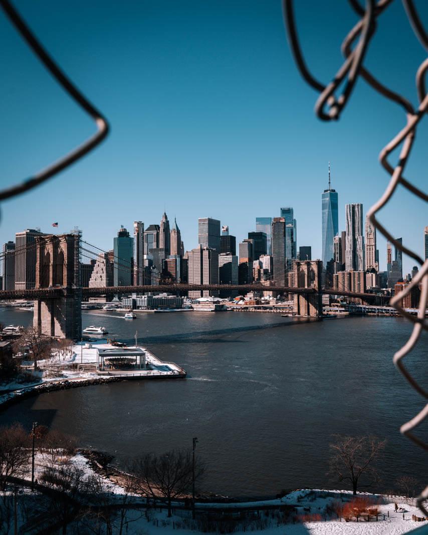 view of New York skyline and Brooklyn bridge from Manhattan Bridge