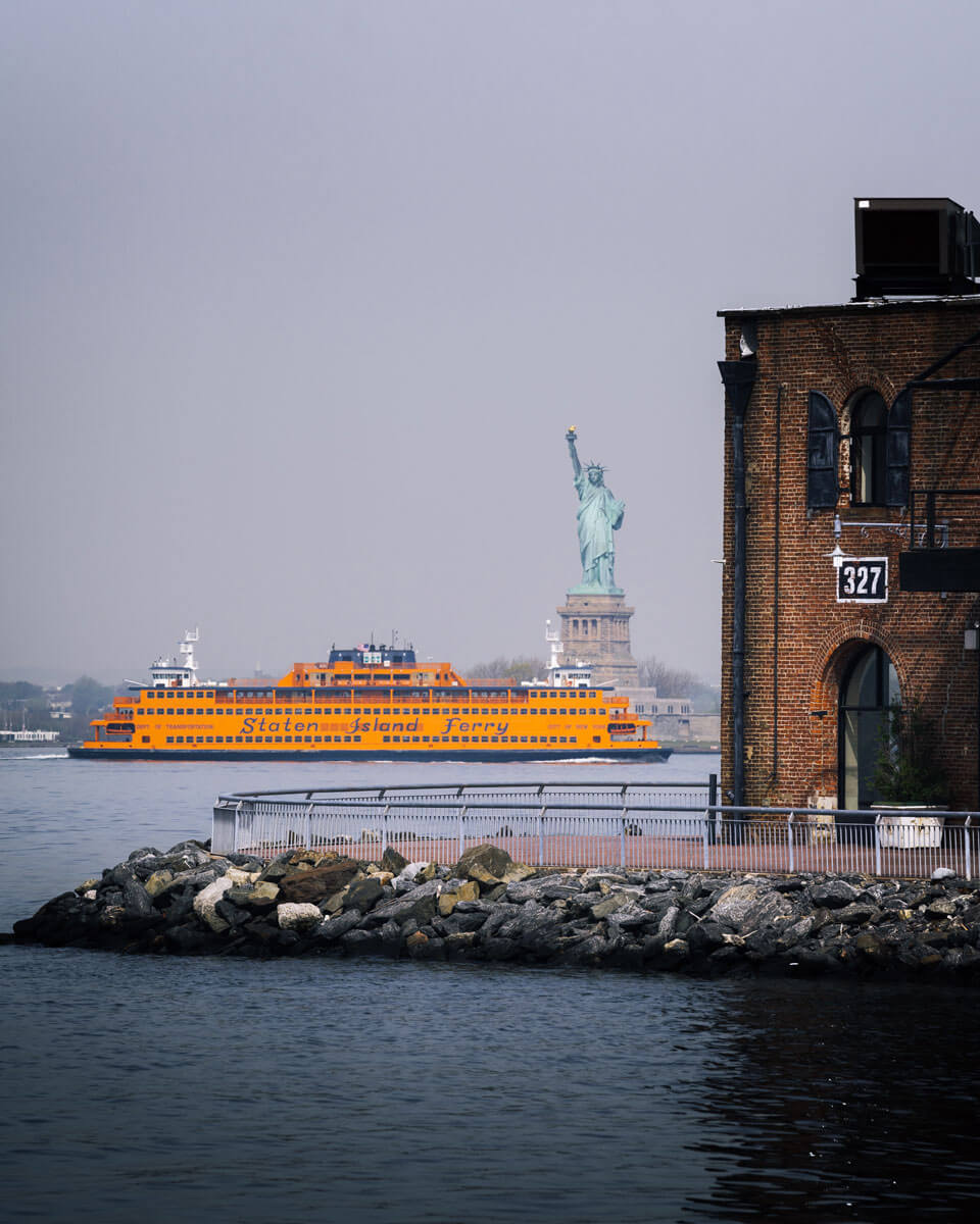 staten-island-ferry-passing-statue-of-liberty-view-from-red-hook-brooklyn