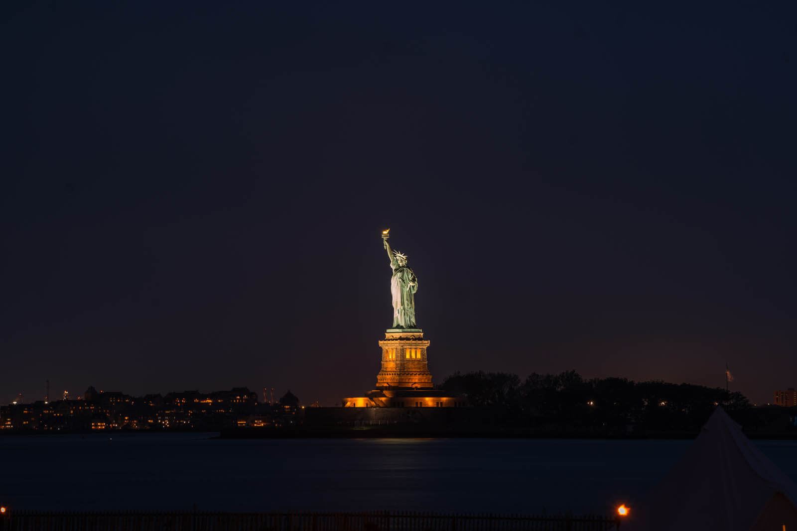Statue of Liberty at night view from Governors Island