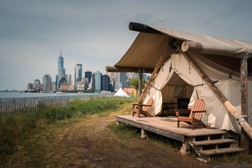 day time view of the summit tent and lower manhattan from Governors Island glamping with Collective Retreats