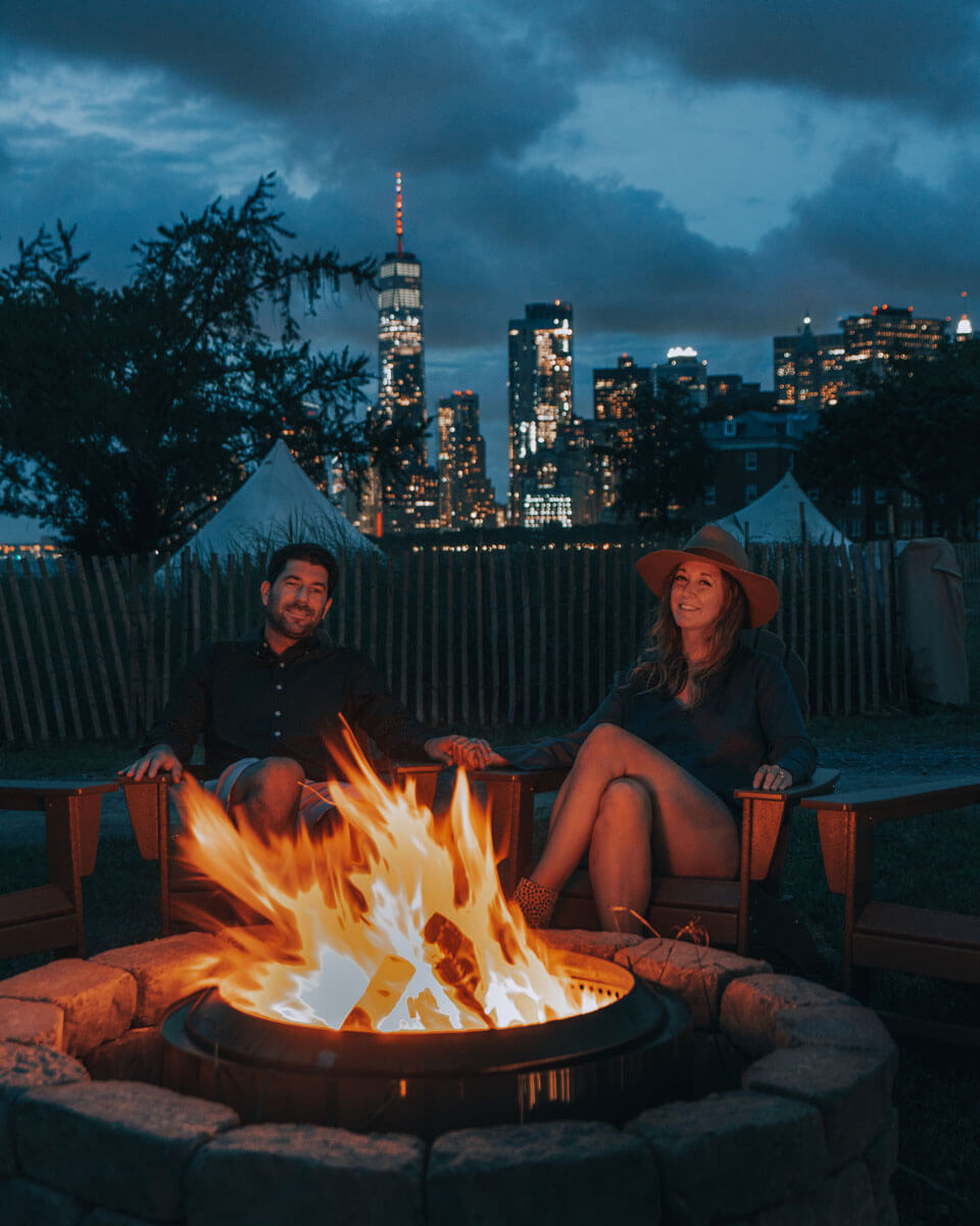enjoying-the-fire-pits-at-collective-retreats-at-governors-island-with-view-of-the-world-trade-center