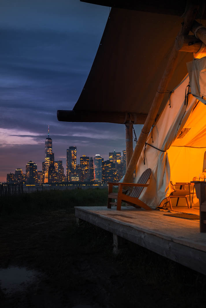 front deck view of the world trade center from glamping at Collective Retreats Governors Island