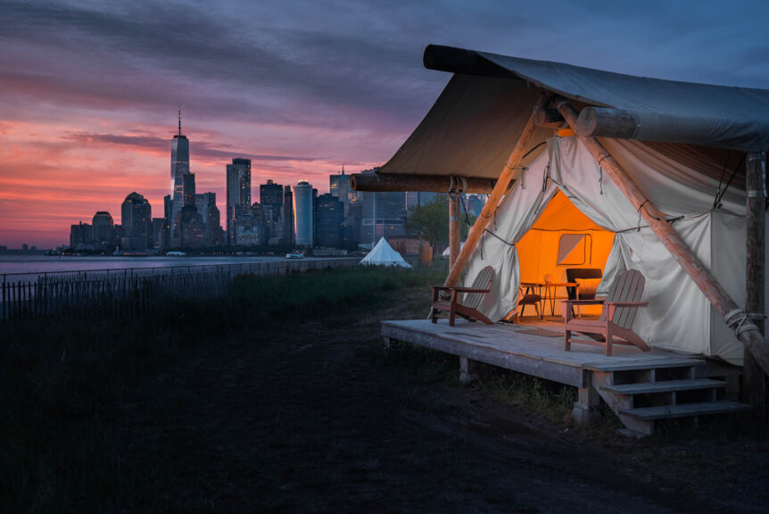 sunset view in front of summit glamping tent at governors island