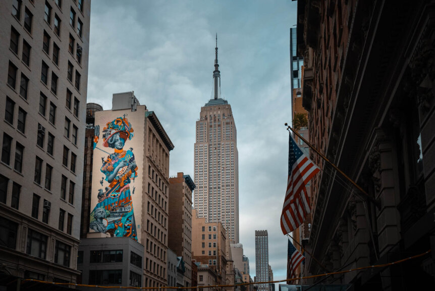 Empire State Building view with Mural on 5th Ave in NYC