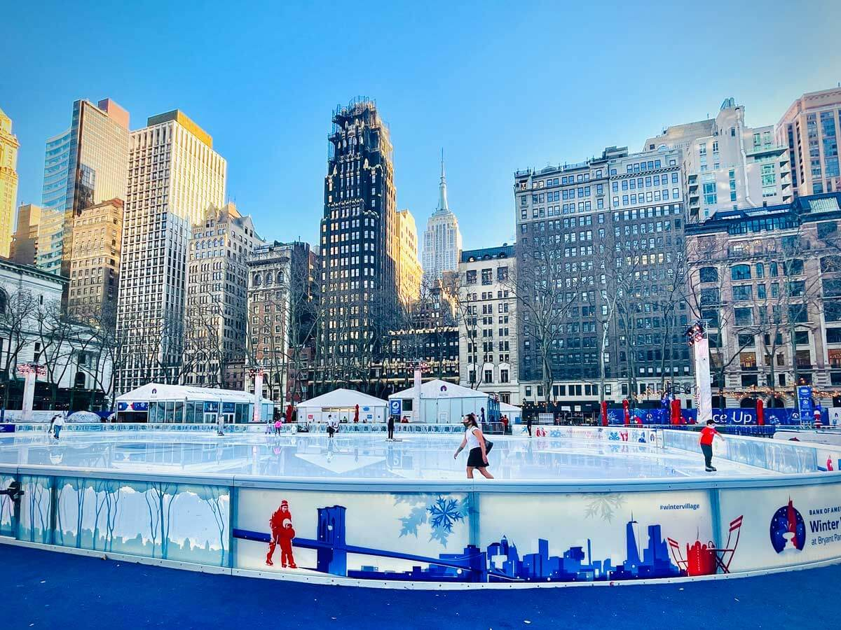 Empire-State-Building-with-an-ice-skater-at-Bryant-Park-in-NYC