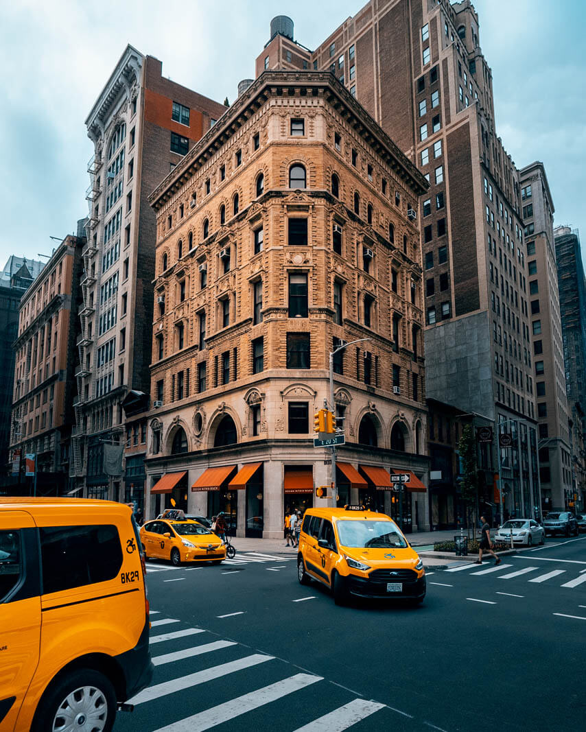 pretty Building on E 19th Street with Taxi in Manhattan NYC