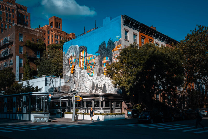 Empire Diner in NYC with a Kobra Mural above it