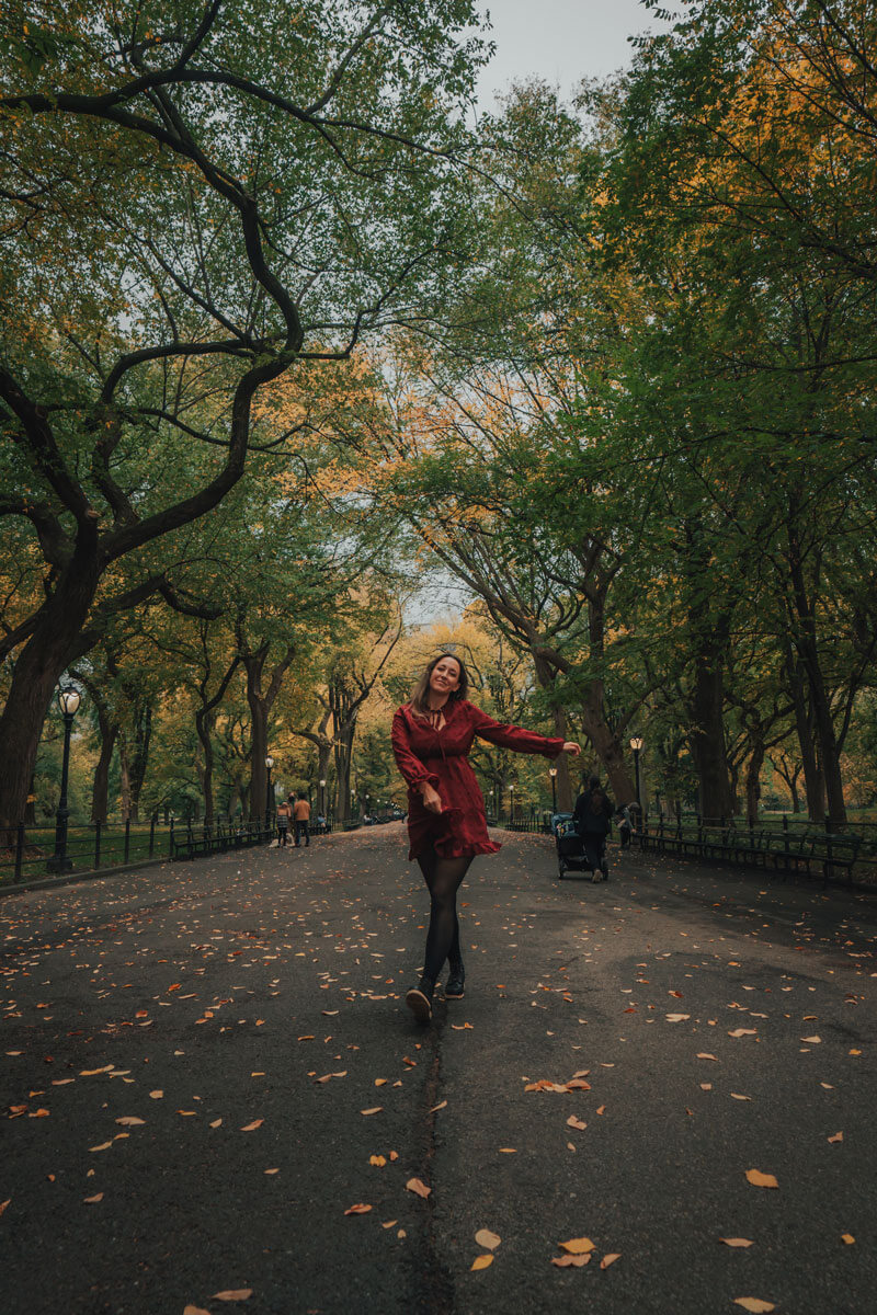 Megan-walking-through-the-Literary-Walk-in-Central-Park-in-NYC-in-the-fall
