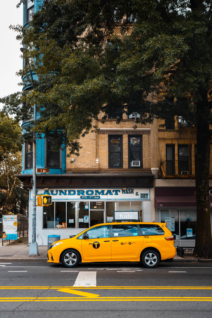taxi cab and park slope laundromat in Brooklyn
