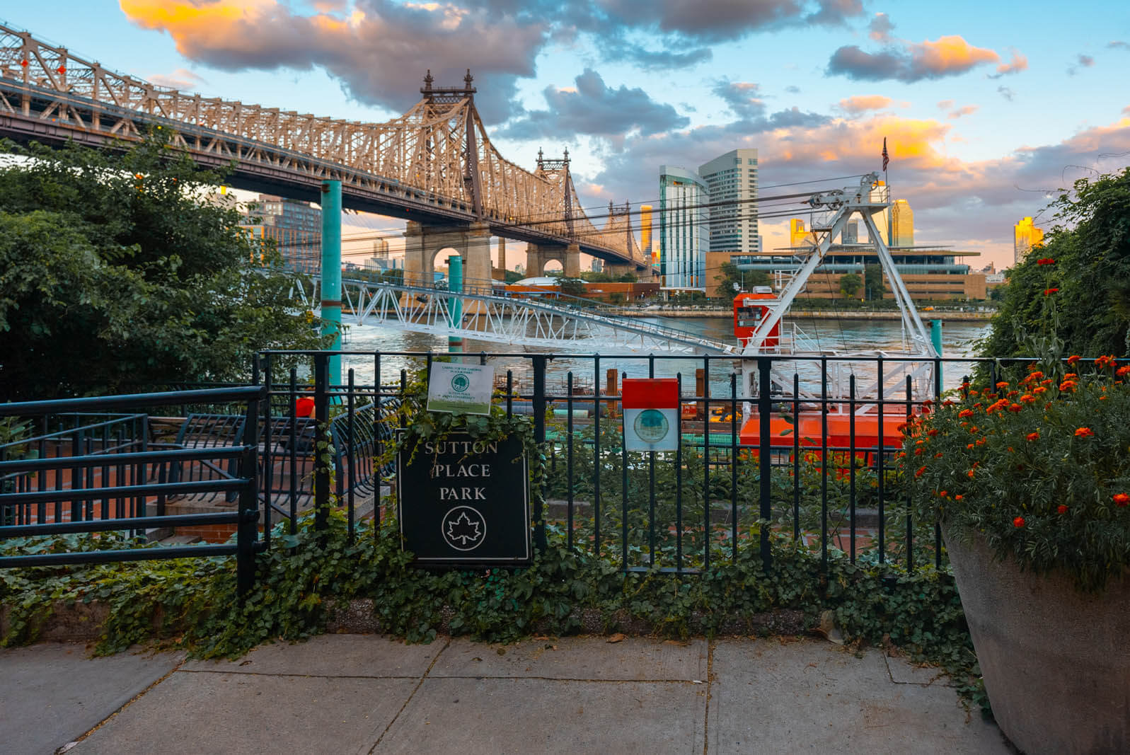 view of the Queensboro Bridge from the hidden Sutton Place Park in Manhattan NYC