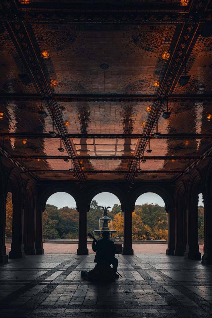 man playing music in Bethesda Terrace in Central Park in NYC